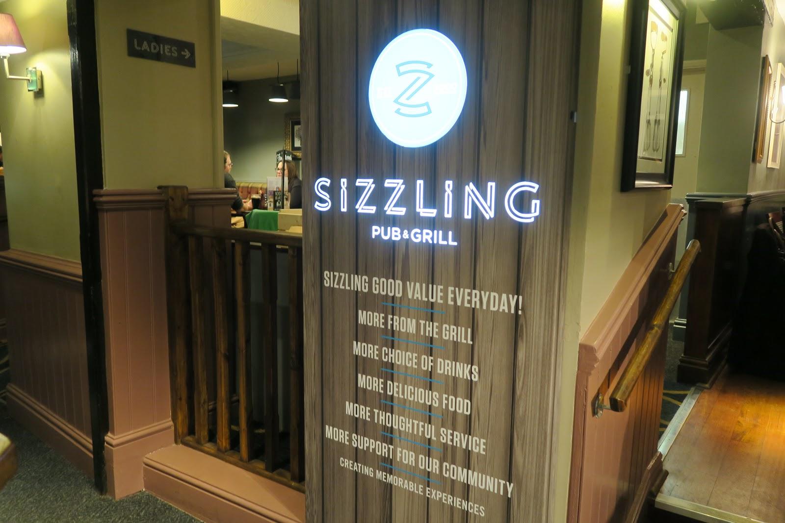 custom neon font for Sizzling Pub